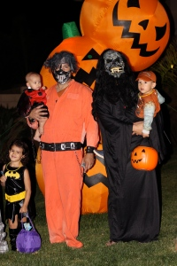 Uncle Dan and Daddy with Kaelyn (batgirl), Kiley (Ladybug) & Chace (Tow Mater)